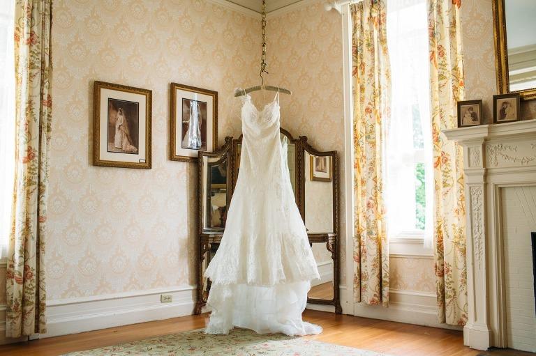 Wedding dress hangs in bridal suite at Cairnwood Estate