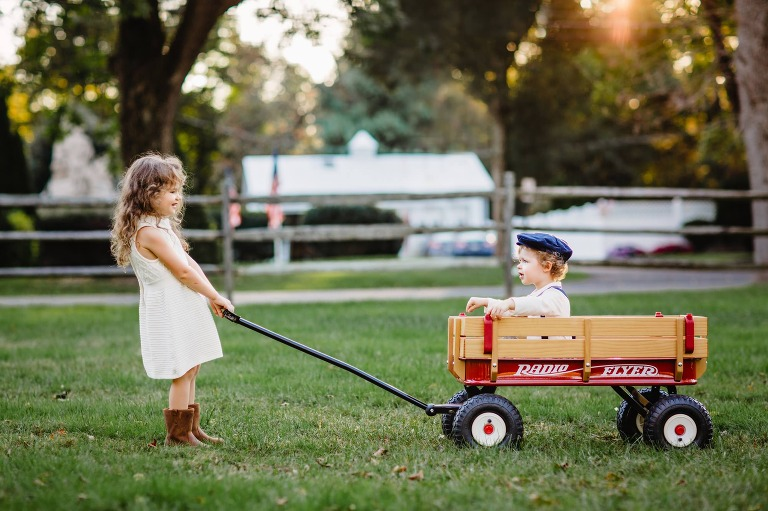 brother and sister in Washington Crossing Park with Radio Flyer Wagon