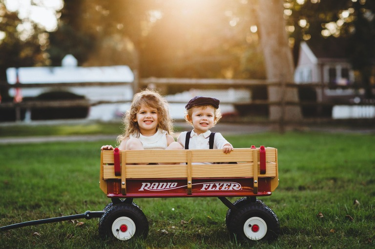 Children in Radio Flyer wagon at family portrait session in Bucks County, PA